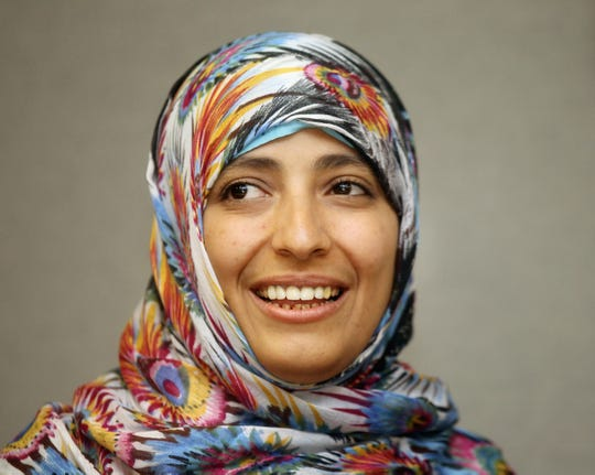 "NEW YORK, NY - OCTOBER 19:  2011 Nobel Peace Prize winner Tawakkul Karman from Yemen smiles during a meeting with United Nations Secretary-General Ban ki-moon at U.N. headquarters on October 19, 2011 in New York City. Karman was awarded the prize for her actions during the Yemen uprising and is often called the ""mother of Yemen?s revolution."""