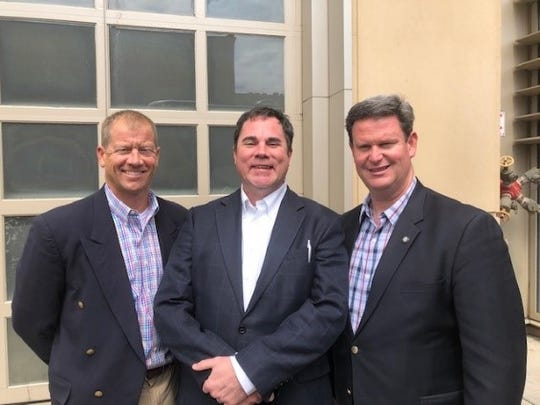 Nat Higdon of TC Federal Bank, Blake Dowling and Mayor John Dailey on the trip to Greenville, South Carolina.