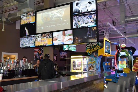 Hangar 38, a new entertainment venue and restaurant opening at Bannerman Crossing, has more than 70 arcade games ranging from basketball to racing to chance games.