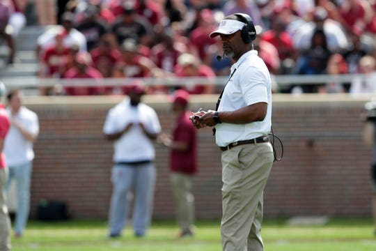 Florida State Seminoles head coach Willie Taggart watches as his players face off against each other. Florida State hosts its Garnet and Gold Spring Game Saturday, April 6, 2019.