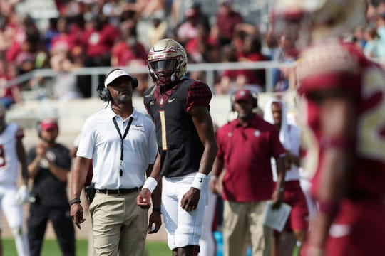 Florida State Seminoles head coach Willie Taggart talks with Florida State Seminoles quarterback James Blackman (1). Florida State hosts its Garnet and Gold Spring Game Saturday, April 6, 2019.