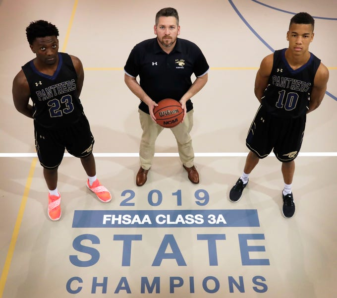 St. John Paul II's boys basketball team recorded its first state championship this season, winning Class 3A while going 28-5. Fifth-year Panthers head coach Titus Nixon was chosen as the 2019 All-Big Bend Coach of the Year, while the rest of the awards were swept with senior guard Allan Jeanne-Rose (right) taking Player of the Year and senior forward Chosen Levarity (left) earning Defensive Player of the Year.