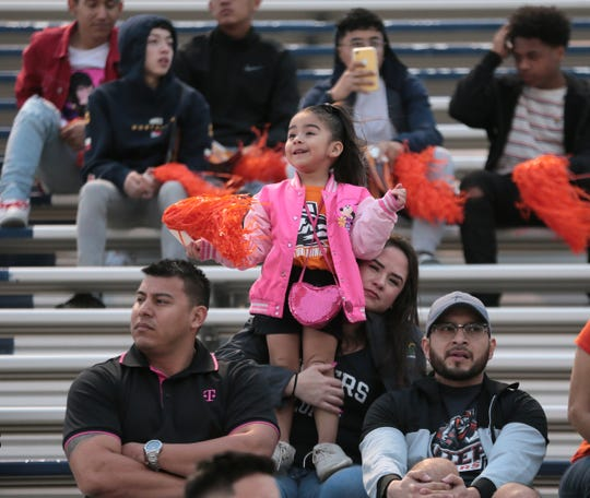 Fans watch the UTEP football team practice Friday, April 5, 2019, at Del Valle High School.