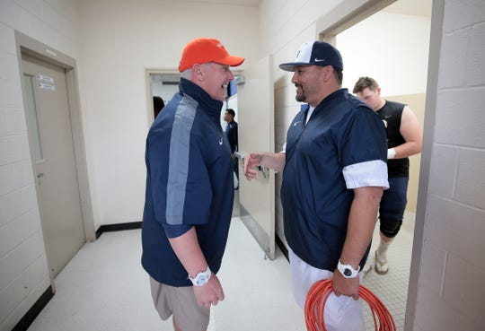UTEP head coach Dana Dimel, left, talks with Del Valle High School head football coach Jesse Perales as the team arrives at the high school Friday, April 5, 2019.