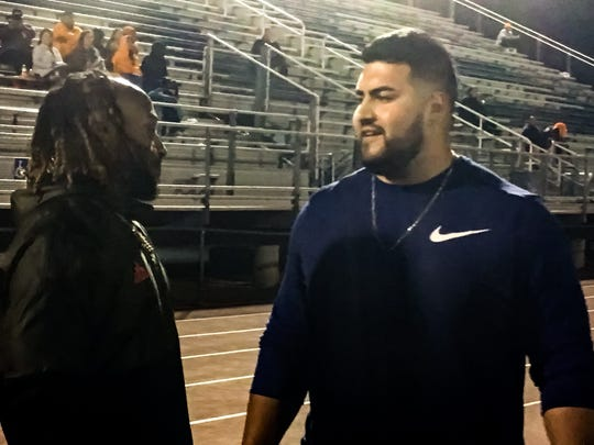 Aaron Jones, left, and Will Hernandez catch up during UTEP's spring football practice at Del Valle on Friday, April 5, 2019.