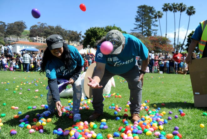 Zenida Lopez and Ray Torres, volunteers with River Community Church, helped disperse eggs for a recent Easter egg hunt at Mission Park in Ventura.
