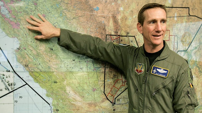 """In this April 12, 2006, file photo, Air Force then-Lt. Col. Clay """"Slam"""" Garrison explains the units area of coverage on a map of California in Fresno."""