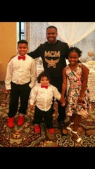 A reward, up to $5K, is posted for the tip that leads the arrest of those who killed Walter Lee Brown III of Vineland, pictured here with his three children.