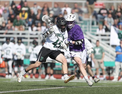 Yorktowns's Blake Borges (45) works againsy John Jay-Cross River's Bryce Ford (9) during their 8-3 win over John Jay-Cross River in boys lacrosse at Yorktown High School in Yorktown on Saturday, April 6, 2019.