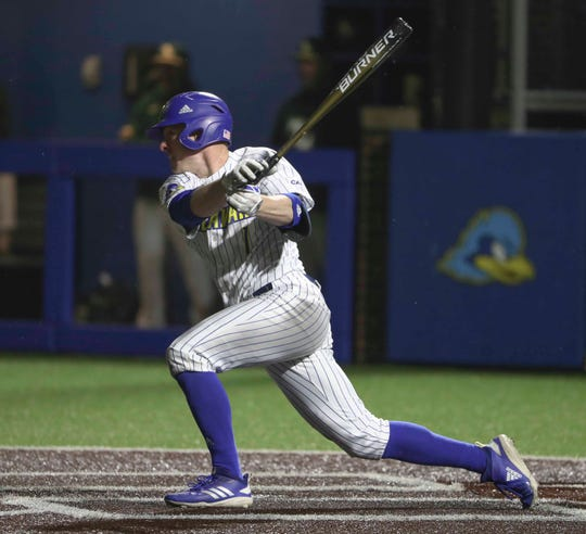 Delaware's Kevin Mohollen plates the only run of the game on a sixth-inning single during the University of Delaware's first night game at Bob Hannah Stadium, a 1-0 win against conference rival William and Mary Friday.