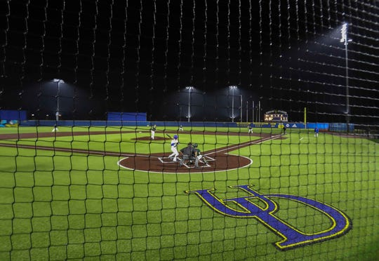 Bright lights illuminate Bob Hannah Stadium during the University of Delaware's first home night game, a 1-0 win against conference rival William and Mary Friday.