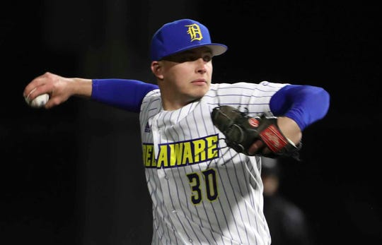 Blue Hen Derek Wakeley throws in relief during the University of Delaware's first night game at bob Hannah Stadium, a 1-0 win against conference rival William and Mary Friday. Wakeley received the win as he and starter Joey Silan shared the shutout.