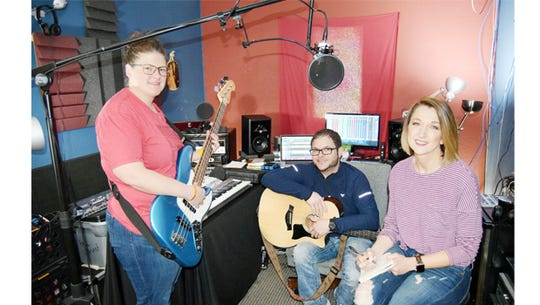 Krista Hunt, Jeff Livsey and Jennifer Harris talk music in the mixing room at Lighthouse Assembly Church. Livsey mixed the band's album in this space.