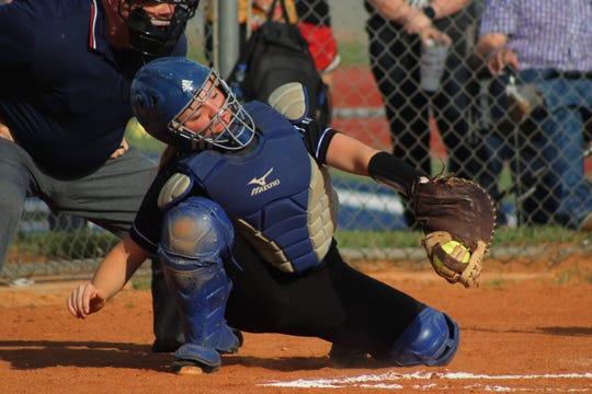 Mackenzie Cave catches the ball for City View in their 6-2 victory over Henrietta.