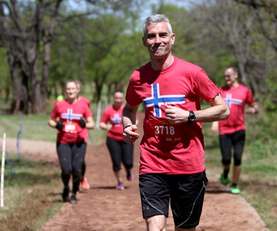 A group of Norwegian runners take part in T.H.O.R. Saturday, April 6, 2019, in Lucy Park.
