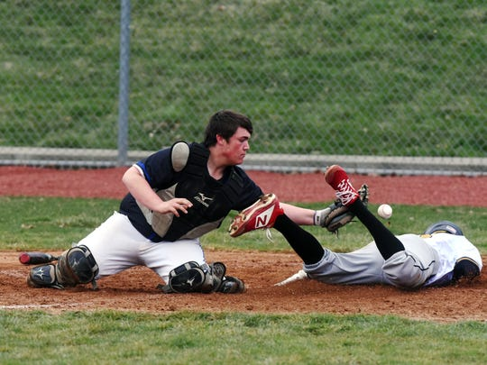 Ethan Guilliams dives into home as the throw home eludes catcher Parker Moorehead in River View's 4-2 win against Zanesville on Friday at Jay Payton Field.