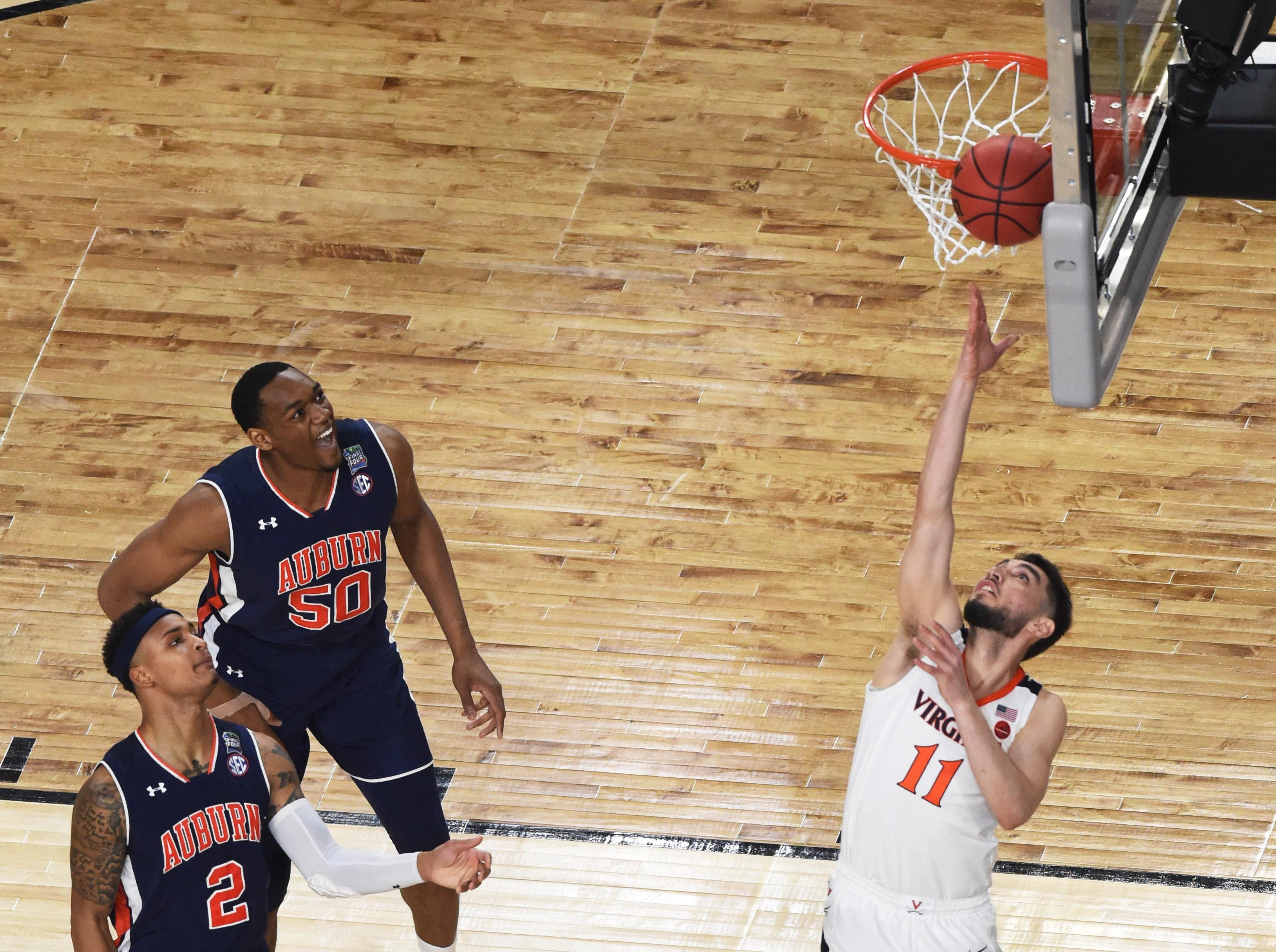 Virginia Cavaliers guard Ty Jerome shoots against the Auburn Tigers.