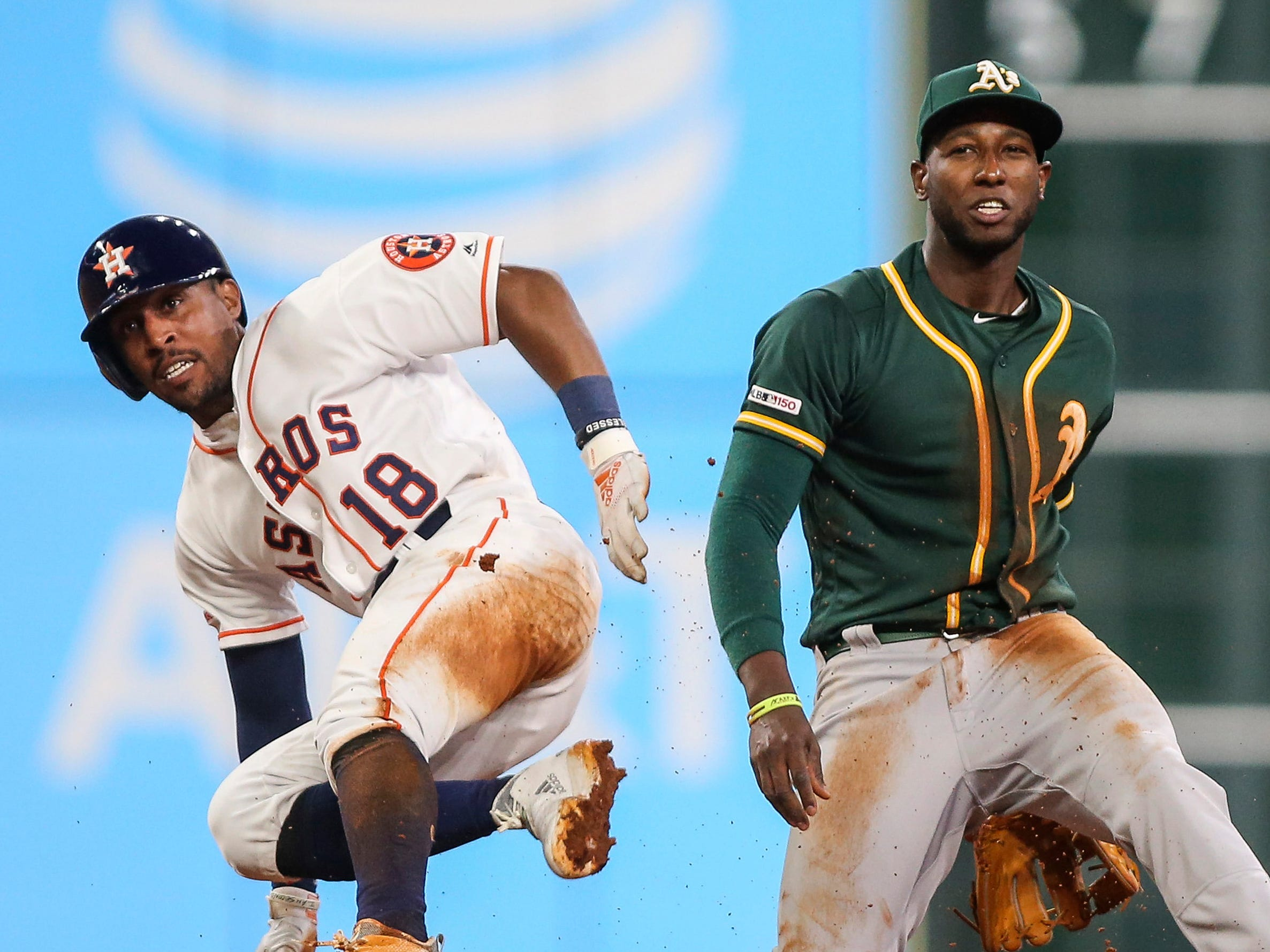 April 5: Houston's Tony Kemp is out and Oakland shortstop Marcus Semien watches as his throw to first completes a double play.