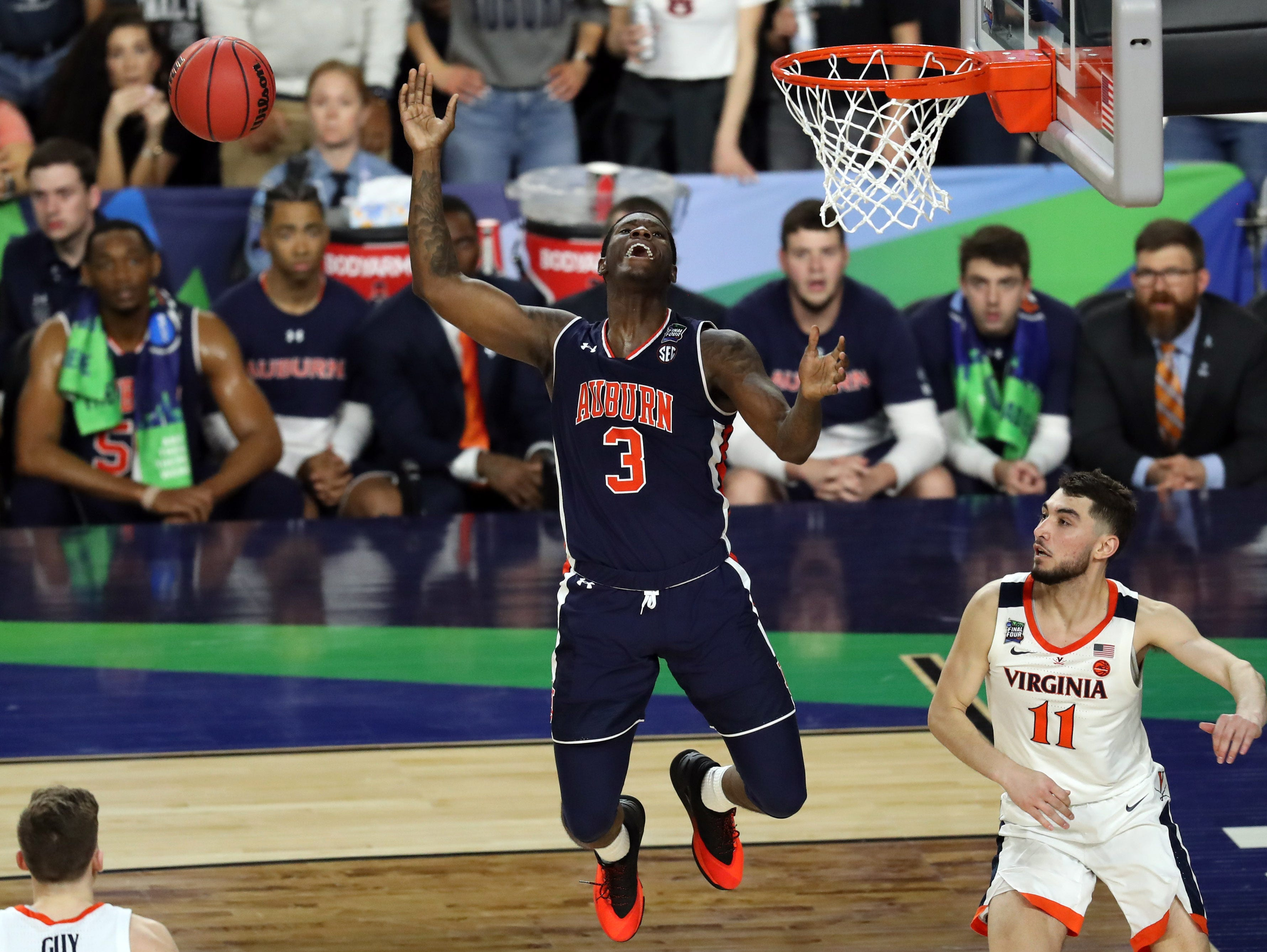 Auburn Tigers forward Danjel Purifoy (3) loses control of the ball against the Virginia Cavaliers.