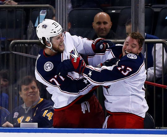 April 5: Columbus Blue Jackets forwards Josh Anderson, left, and Cam Atkinson  celebrate after defeating the New York Rangers in a shootout to clinch a playoff spot.