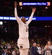 Arike Ogunbowale celebrates Notre Dame's comeback victory over rival Connecticut.