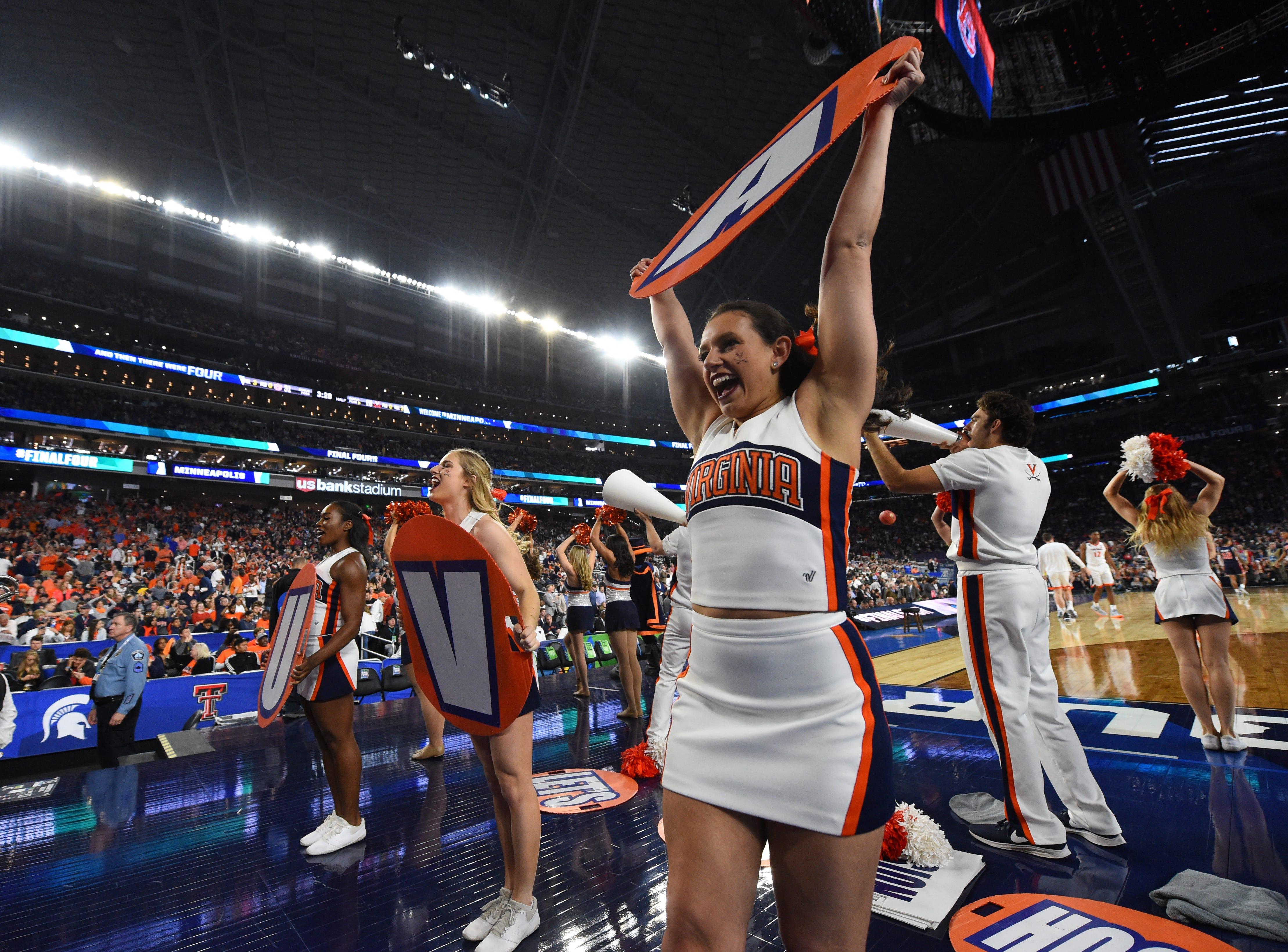 Final Four: Virginia Cavaliers cheerleaders perform during halftime against the Auburn Tigers.