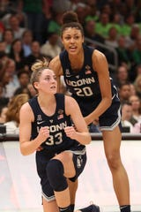 UConn's Katie Lou Samuelson (33) and Huskies Olivia Nelson-Ododa (20) react after a second-half call against Notre Dame.