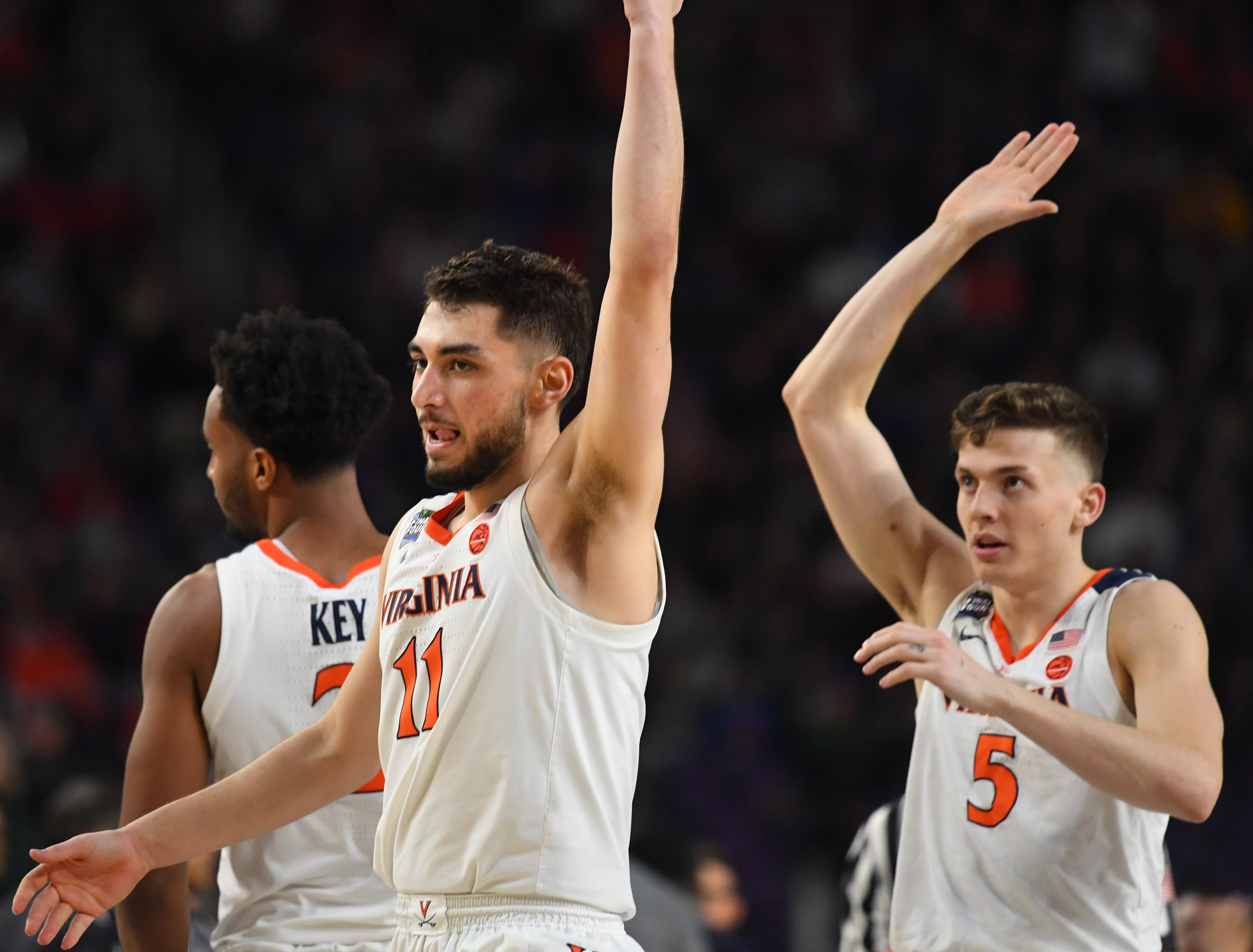 Virginia Cavaliers guard Ty Jerome (11) reacts after hitting a 3-pointer against the Auburn Tigers.
