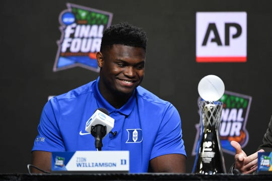 Duke forward Zion Williamson accepts season awards during a Final Four news conference.