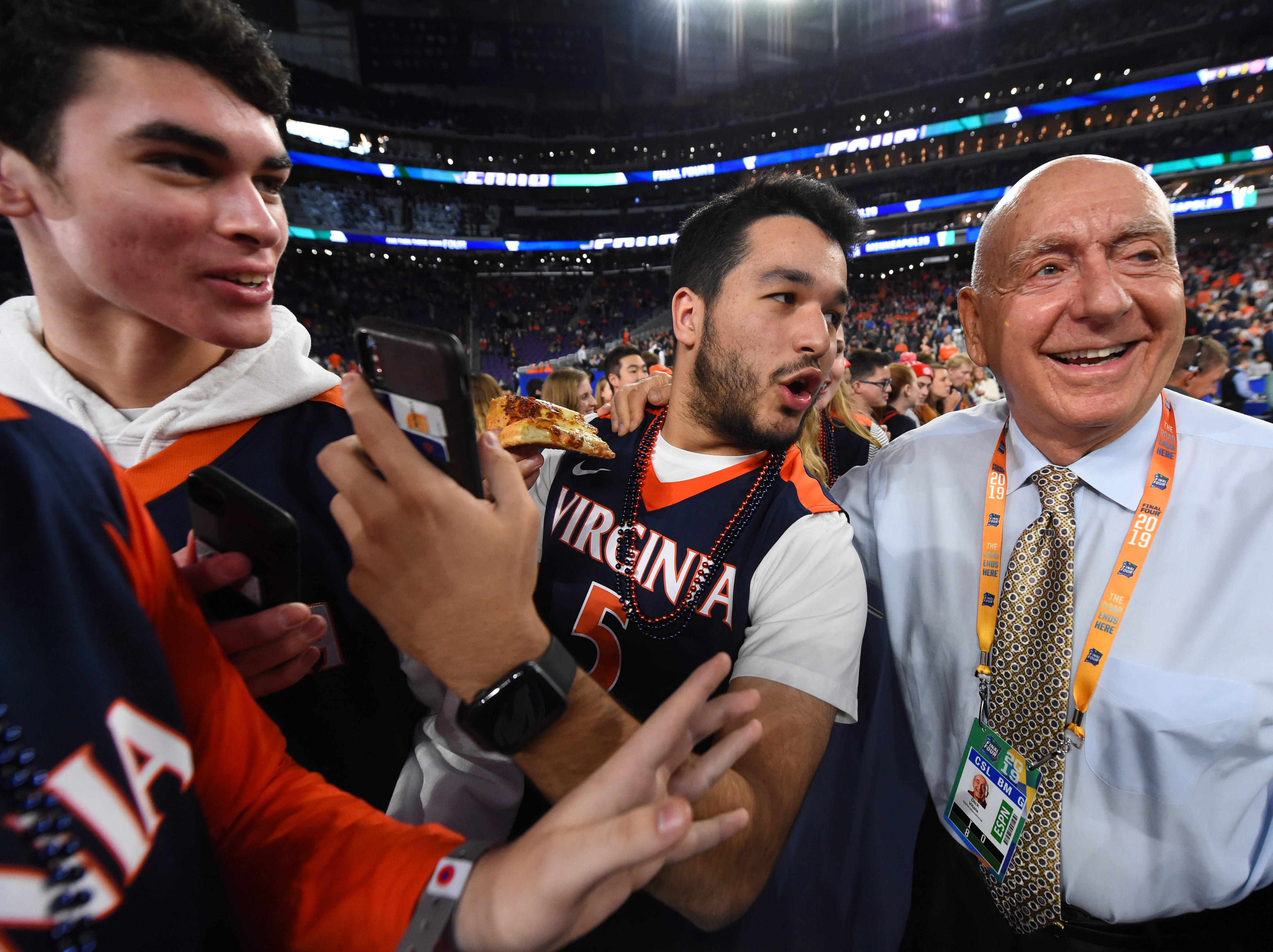 Dick Vitale poses for a photo with Virginia Cavaliers fans.