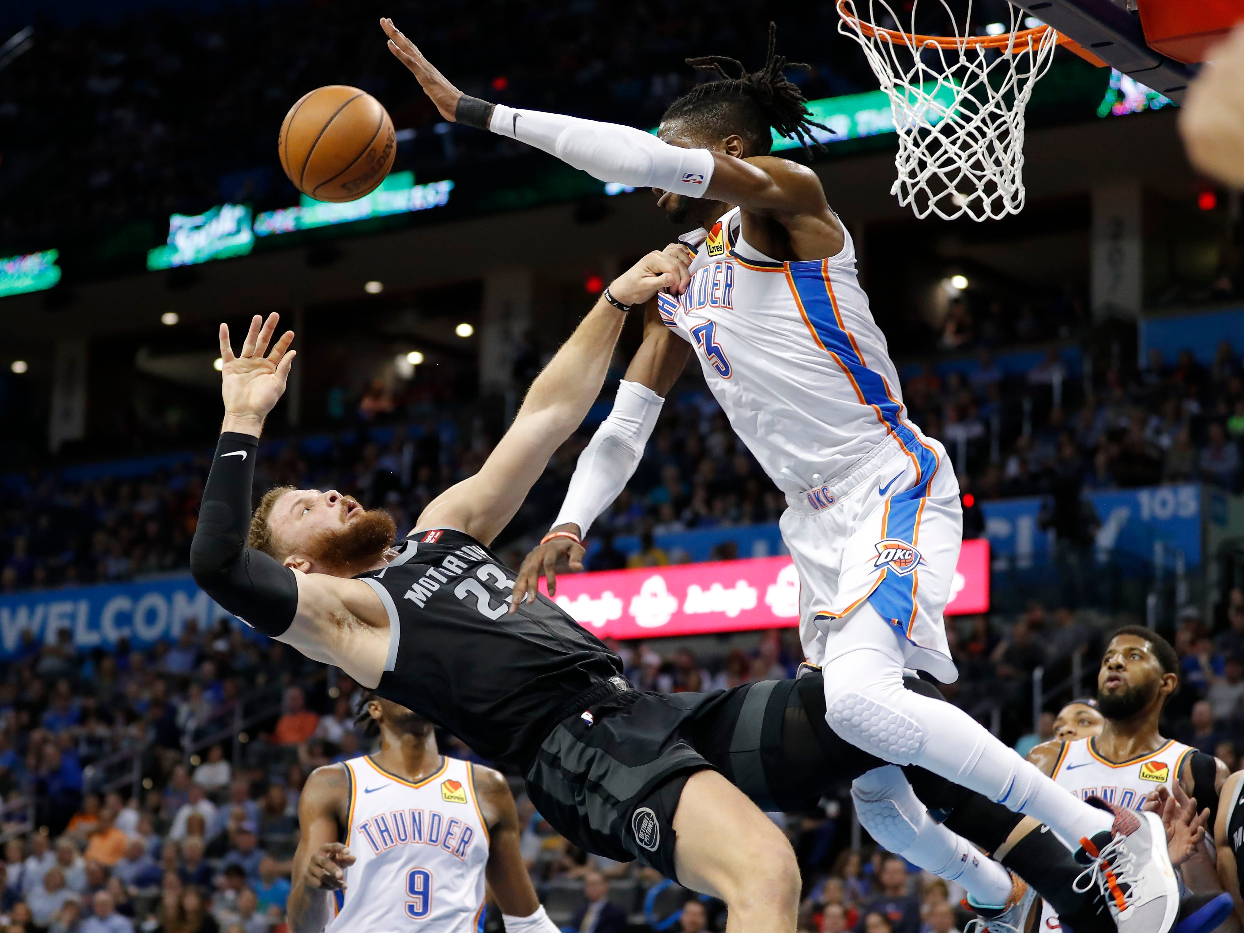 April 5: Pistons forward Blake Griffin (23) collides with Thunder defender Nerlens Noel (3) on his way to the basket during the first half in Oklahoma City.