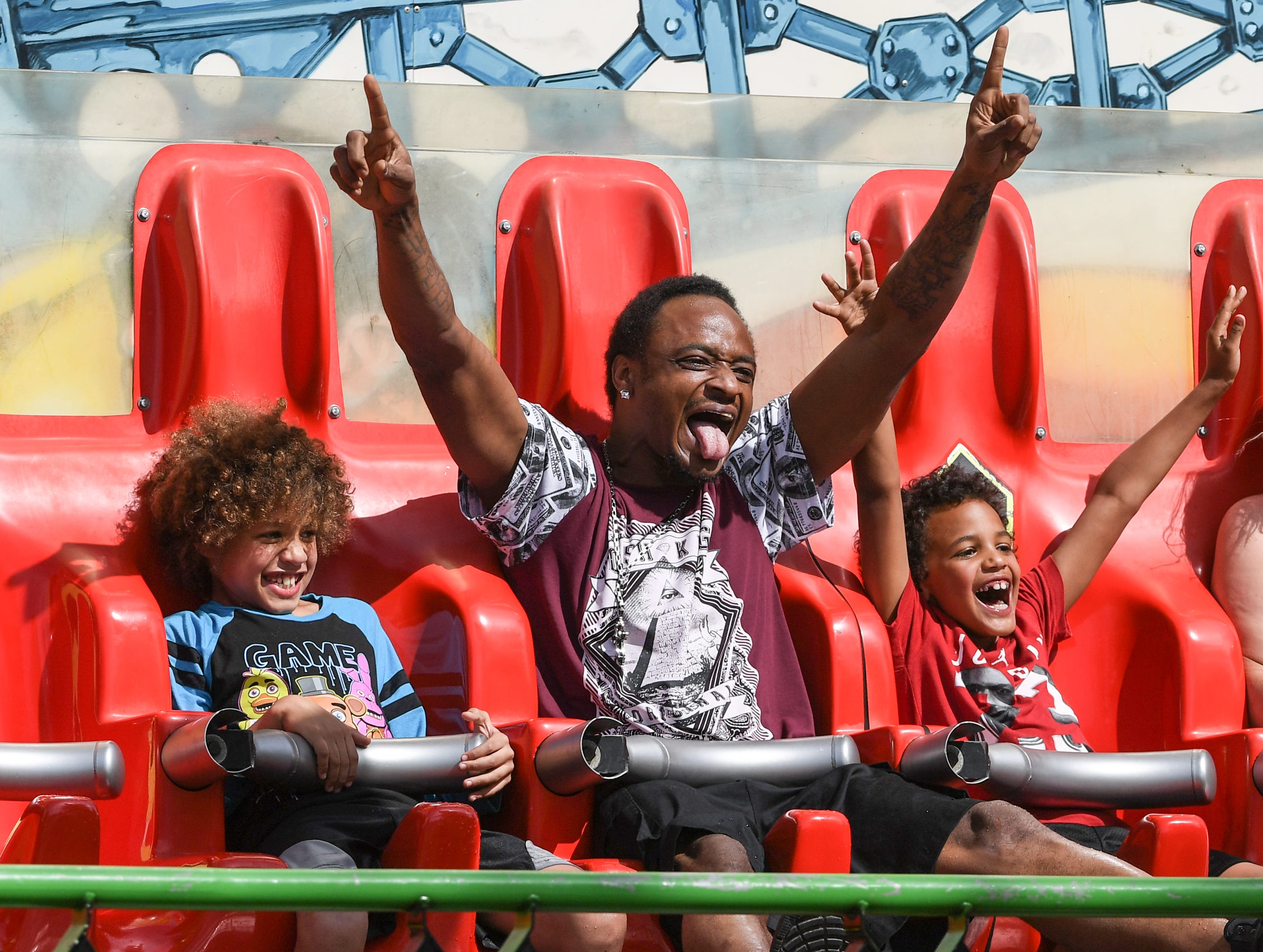 """Happy dad""  Jaden Jenkins, left, his father Leonard Jenkins, and brother Trenton Jenkins enjoy the X Factory ride during the Great Anderson County Fair opening day at the Anderson Sports and Entertainment Complex in Anderson in May."