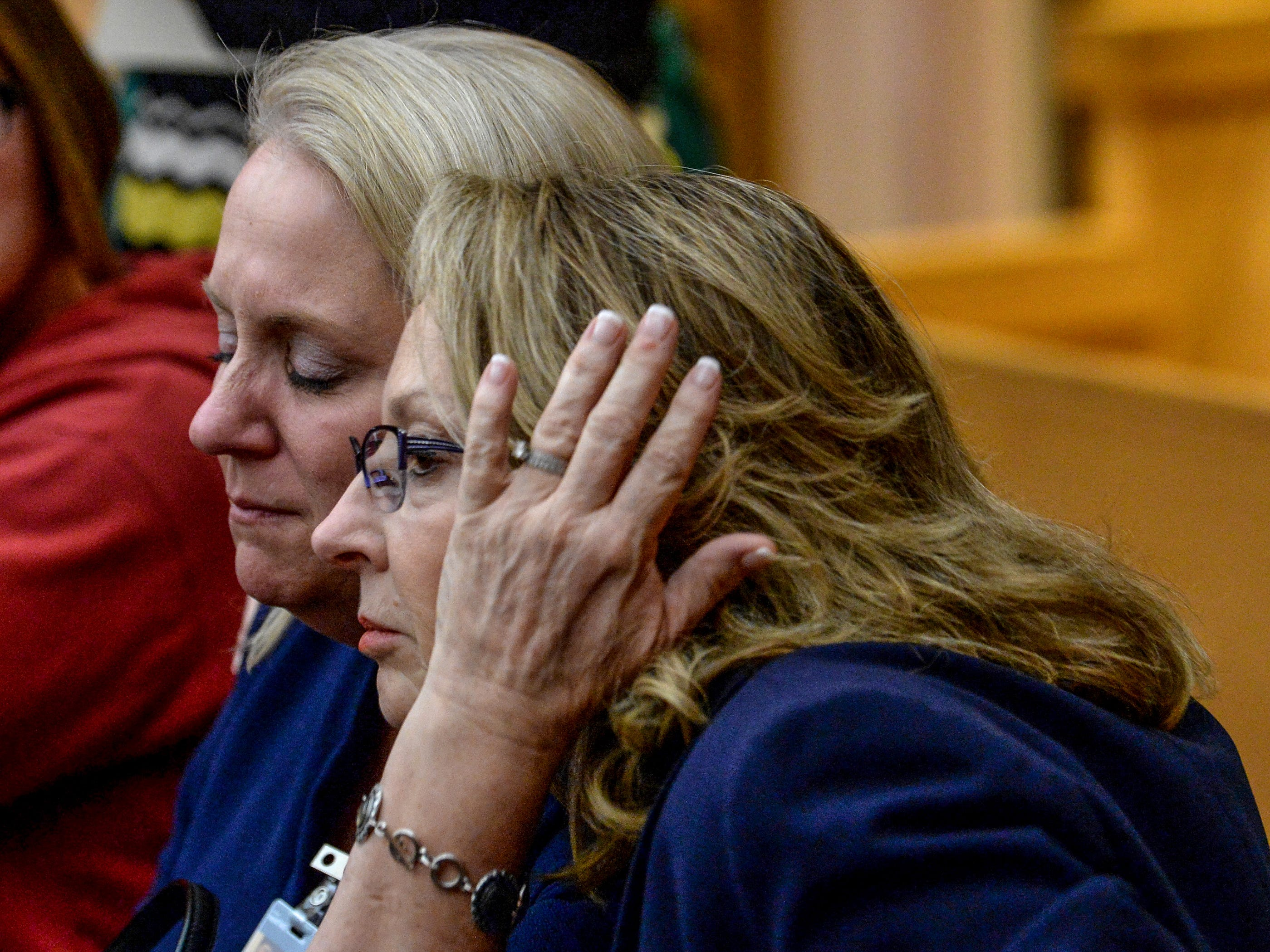 """Townville teen hearing"" Denise Fredricks, left, Principal at Townville Elementary School, hugs Joanne Avery, right, Superintendent of Anderson County School District Four, during a waiver hearing for Jesse Osborne at the Anderson County Courthouse on Monday, February 12, 2018. They finished watching a video of Jesse Osborne being interviewed in 2016 by investigators."