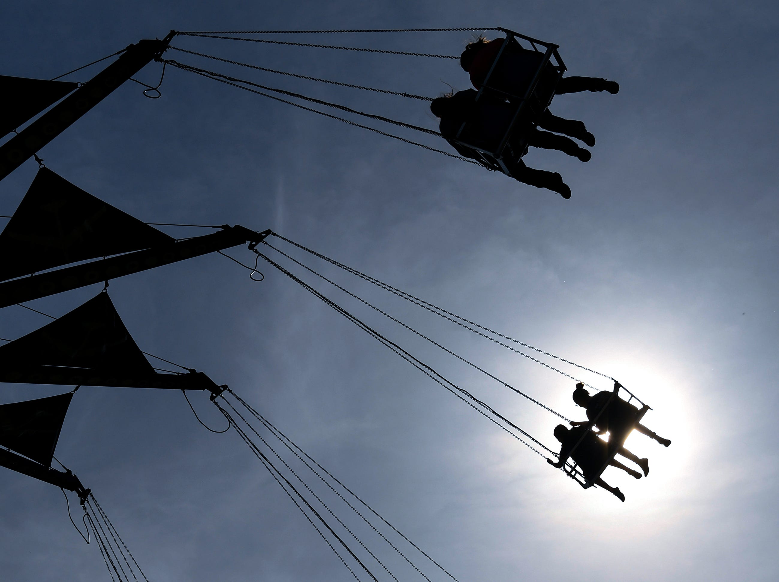 """Spring swing"" - Chairs are filled with people 100 feet off the ground on the Zoogvogel ride during the Great Anderson County Fair opening day at the Anderson Sports and Entertainment Complex."