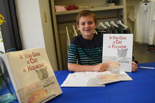 """Brooks Byrd, 9, wrote and illustrated a book called """"If You Give a Cat a Kolache."""" He wrote the book when he was seven and is currently in the process of writing and illustrating his second book."""