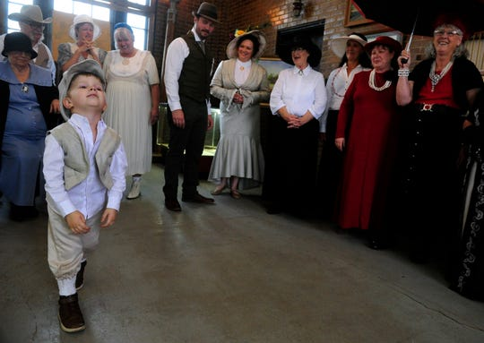 Jonah Charman, 3, impatiently drags his feet as he and others await the decision of judges in a period costume contest held in the Roaring Ranger Oil Boom Museum on Saturday. Jonah came with his parents Joe and Savannah from San Antonio to celebrate the centennial of Ranger's incorporation. The Charman family were one of the winners of the contest.