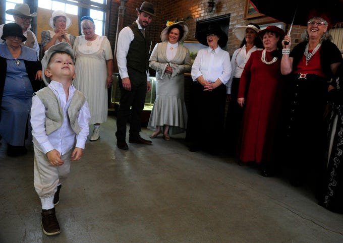 Jonah Charman, 3, impatiently drags his feet as he and others await the decision of judges in a period costume contest held in the Roaring Ranger Oil Boom Museum Saturday April 6, 2019. Jonah came with his parents Joe and Savannah from San Antonio to celebrate the centennial of Ranger's incorporation. The Charman family were named as one of the winners of the contest.