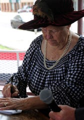 Jeane Pruett, a local historian and former mayor of Ranger, re-enacts the signing of the 1919 town charter Saturday.