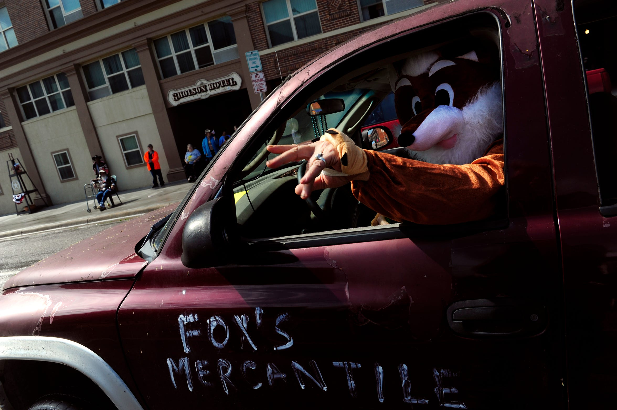 Jeff Angus waves from his pickup during Saturday's centennial parade down Main St. in Ranger April 6, 2019.