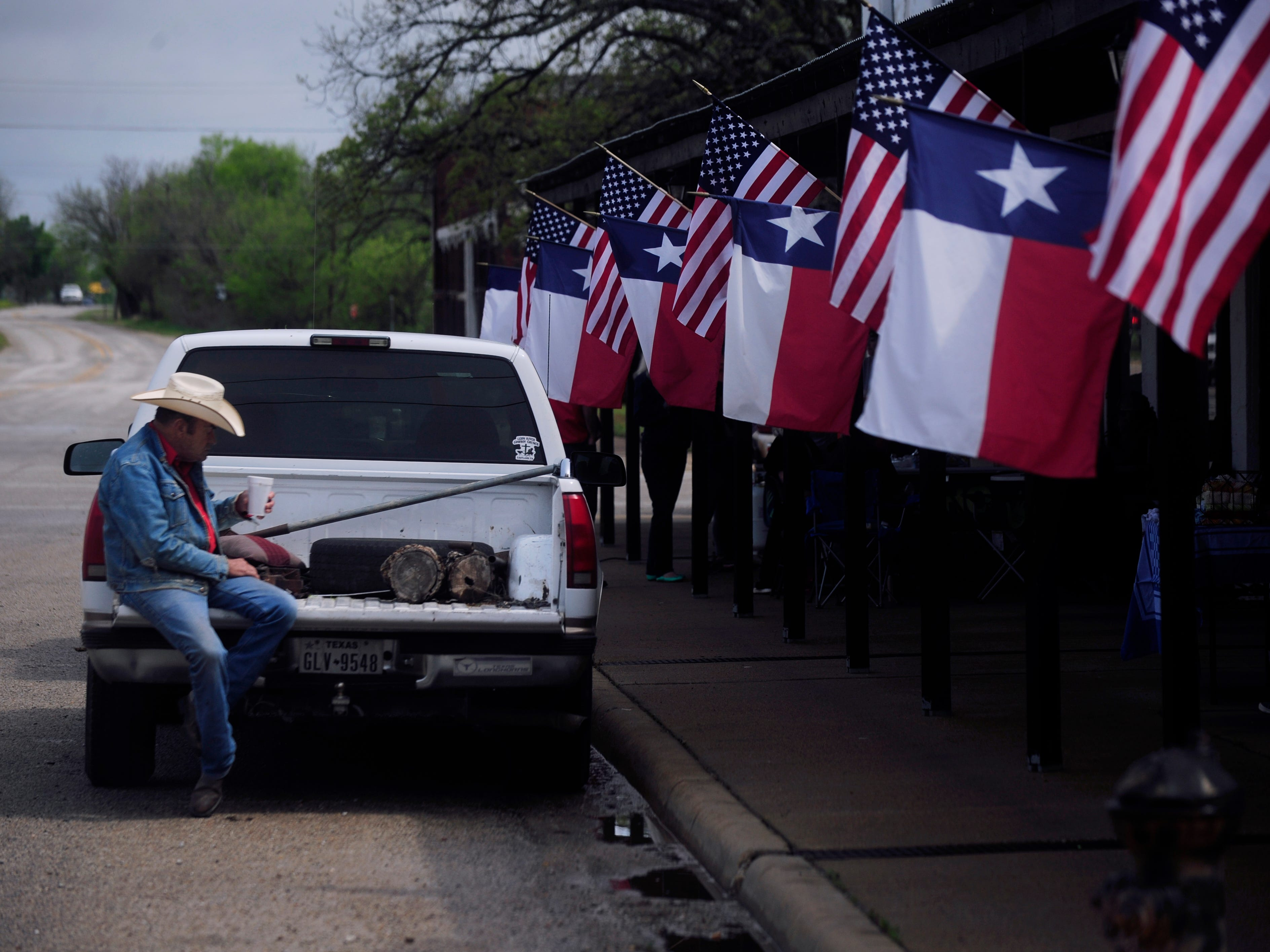 Owen Brackeen sips coffee on the tailgate of a pickup on N. Austin St. in Ranger Saturday April 6, 2019. The town celebrated 100 years since it's charter with a parade, contests, and live music over the weekend.