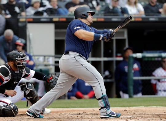 Seattle Mariners' Daniel Vogelbach hits a three-run double against the Chicago White Sox during the third inning of a baseball game in Chicago on Sunday.