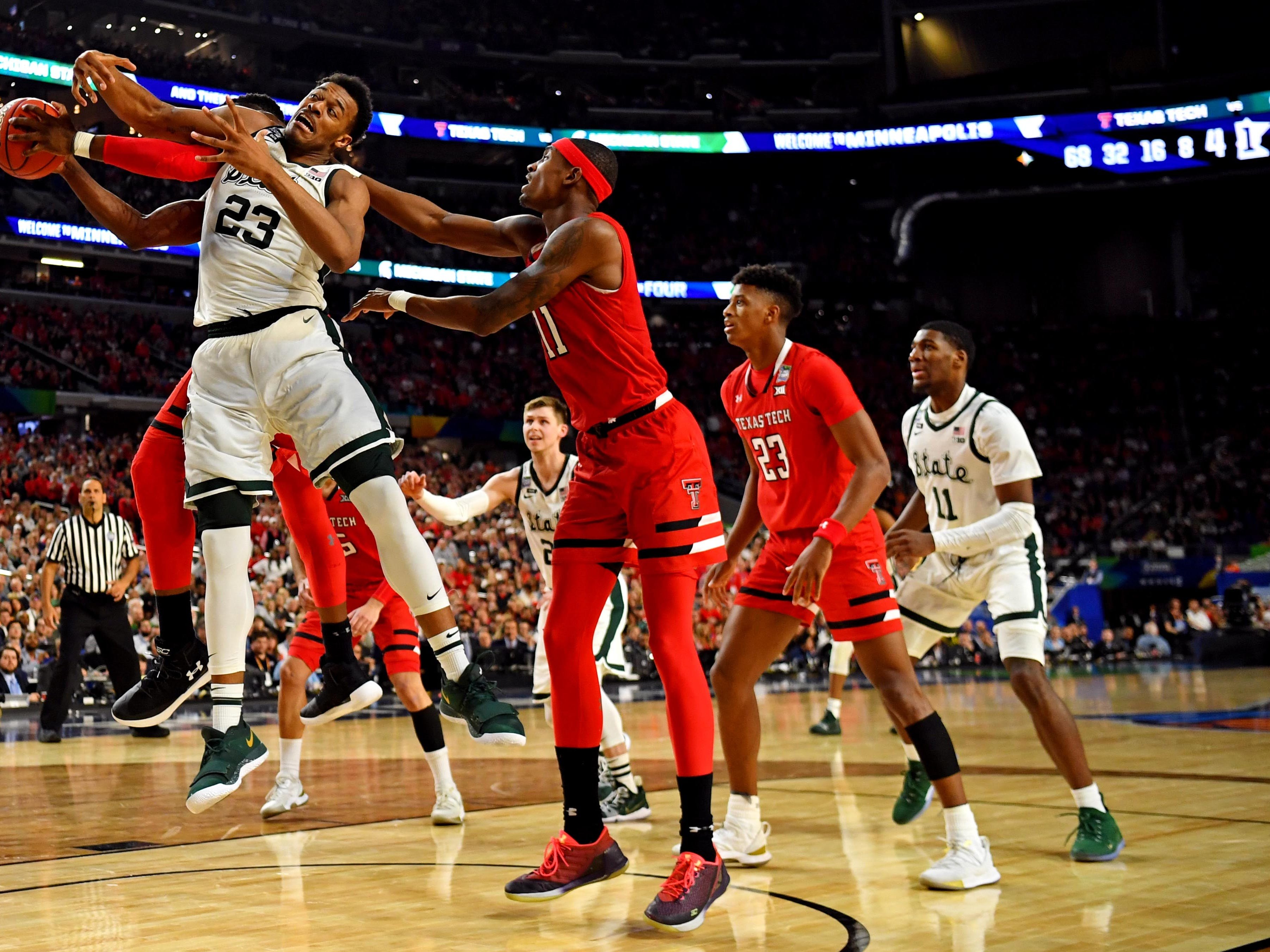 Apr 6, 2019; Minneapolis, MN, USA; Michigan State Spartans forward Xavier Tillman (23) and Texas Tech Red Raiders center Norense Odiase (32) for a rebound during the second half in the semifinals of the 2019 men's Final Four at US Bank Stadium. Mandatory Credit: Bob Donnan-USA TODAY Sports