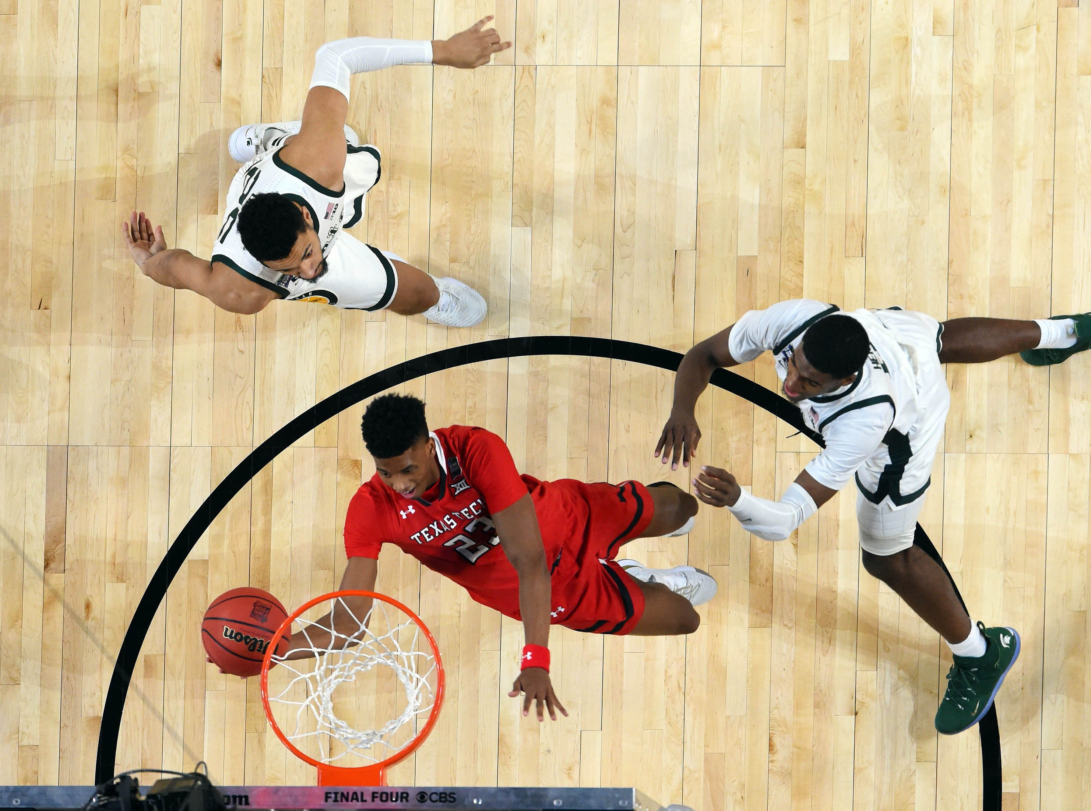 Apr 6, 2019; Minneapolis, MN, USA; Texas Tech Red Raiders guard Jarrett Culver (23) shoots a lay up as Michigan State Spartans forward Aaron Henry (bottom) and forward Kenny Goins (top right) look on during the first half in the semifinals of the 2019 men's Final Four at US Bank Stadium. Mandatory Credit: Bob Donnan-USA TODAY Sports