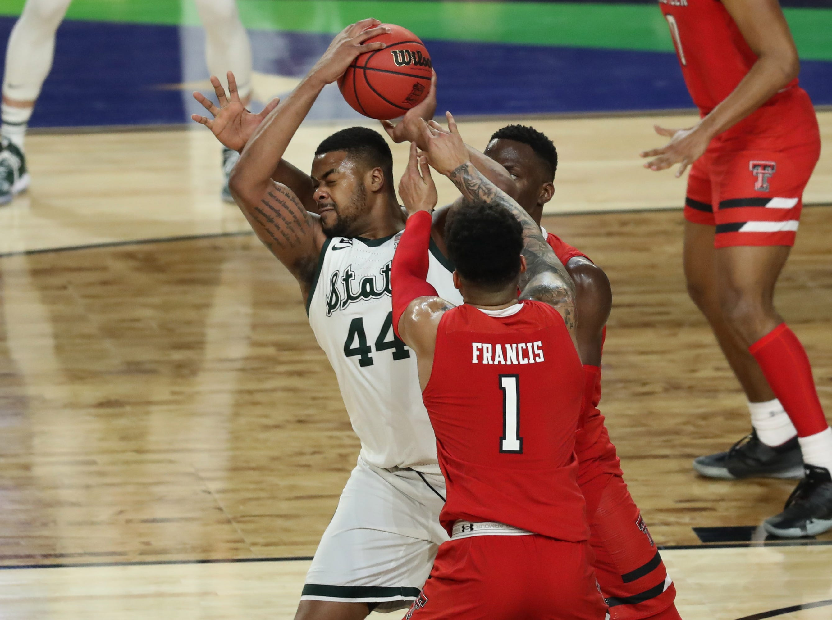 Apr 6, 2019; Minneapolis, MN, USA; Michigan State Spartans forward Nick Ward (44) is pressured by the defense of Texas Tech Red Raiders guard Brandone Francis (1) during the second half in the semifinals of the 2019 men's Final Four at US Bank Stadium. Mandatory Credit: Brace Hemmelgarn-USA TODAY Sports