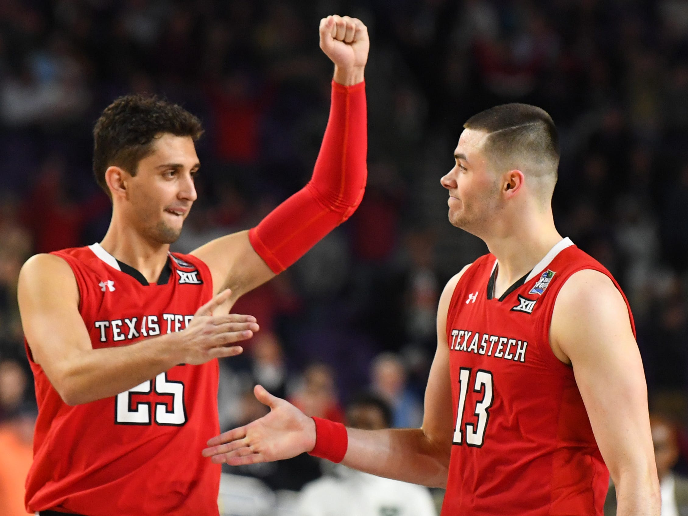 Apr 6, 2019; Minneapolis, MN, USA; Texas Tech Red Raiders guard Matt Mooney (13) and  guard Davide Moretti (25) celebrate their win over the Michigan State Spartans in the semifinals of the 2019 men's Final Four at US Bank Stadium. Mandatory Credit: Robert Deutsch-USA TODAY Sports