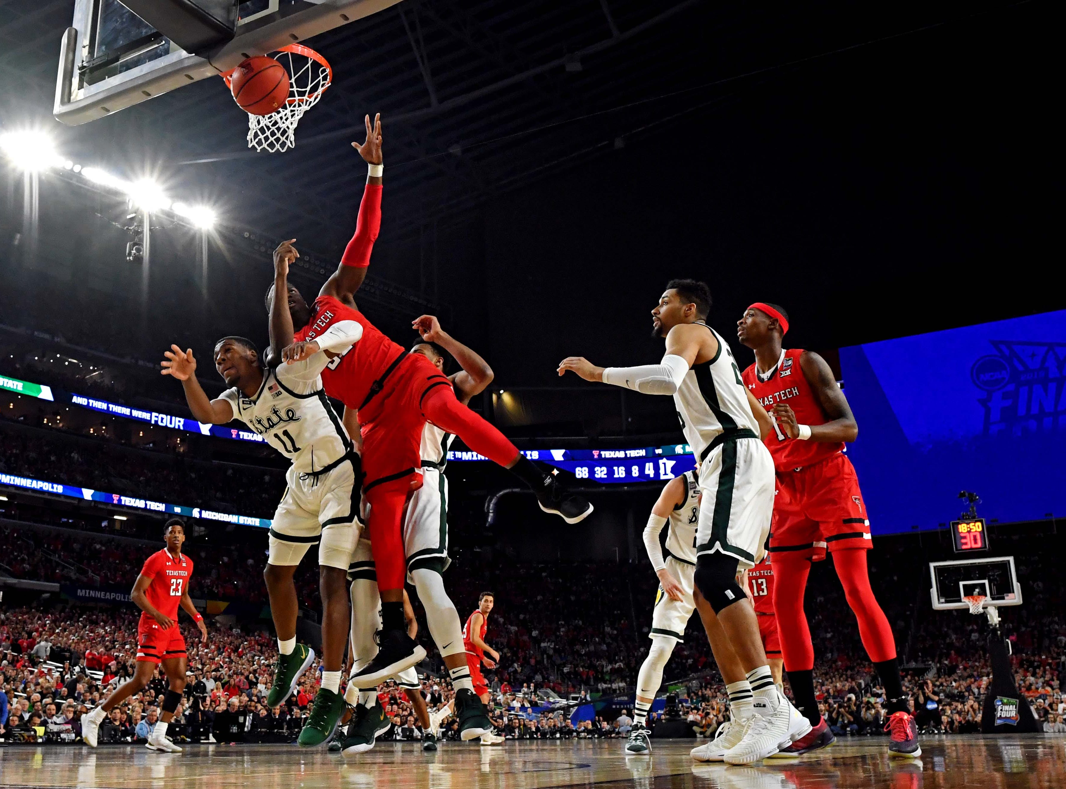 Apr 6, 2019; Minneapolis, MN, USA; Michigan State Spartans forward Aaron Henry (11) and Texas Tech Red Raiders center Norense Odiase (32) go for a rebound during the first half in the semifinals of the 2019 men's Final Four at US Bank Stadium. Mandatory Credit: Bob Donnan-USA TODAY Sports