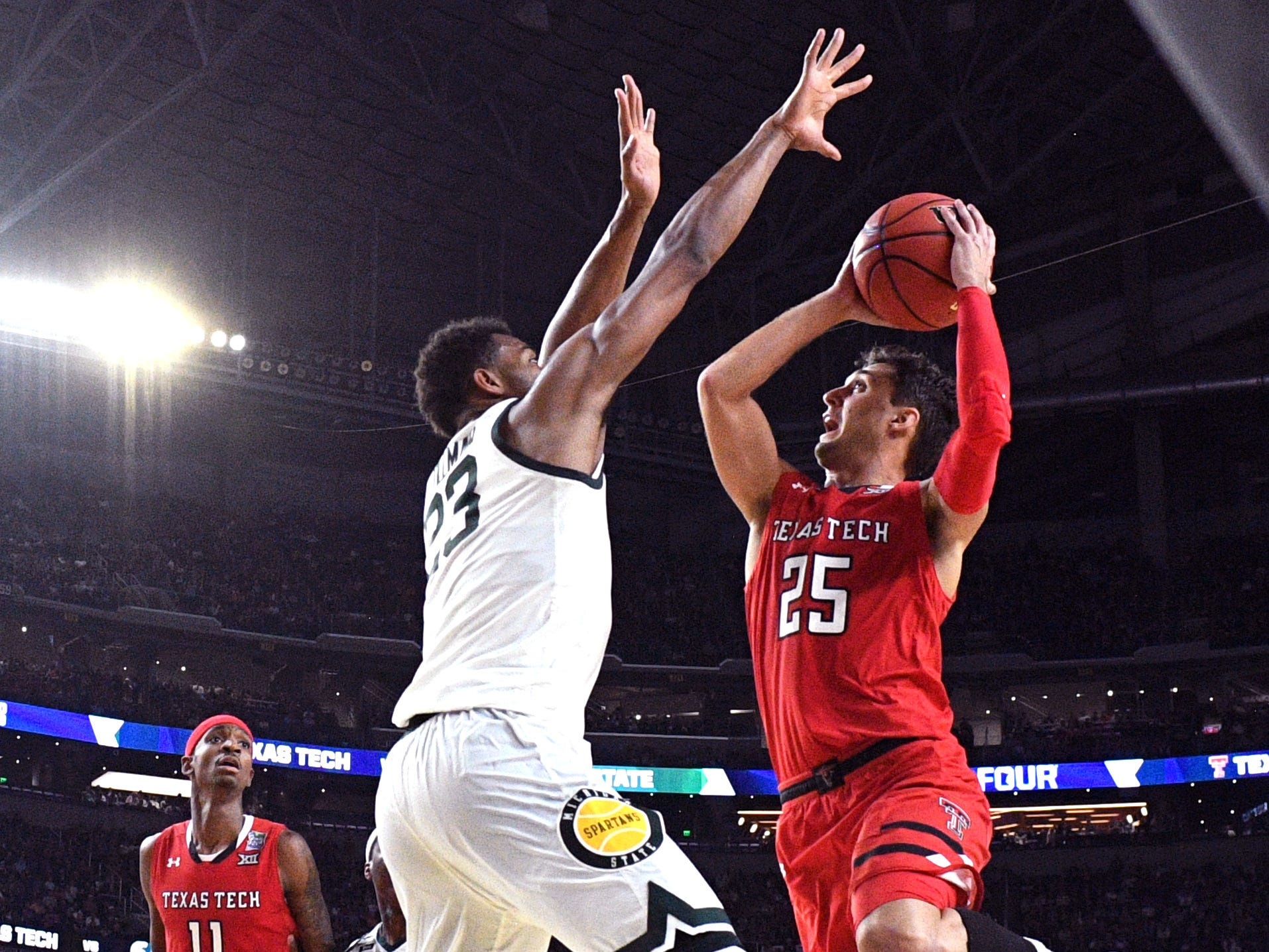 Apr 6, 2019; Minneapolis, MN, USA; Texas Tech Red Raiders guard Davide Moretti (25) shoots the ball defended by Michigan State Spartans forward Xavier Tillman (23) in the semifinals of the 2019 men's Final Four at US Bank Stadium. Mandatory Credit: Robert Deutsch-USA TODAY Sports