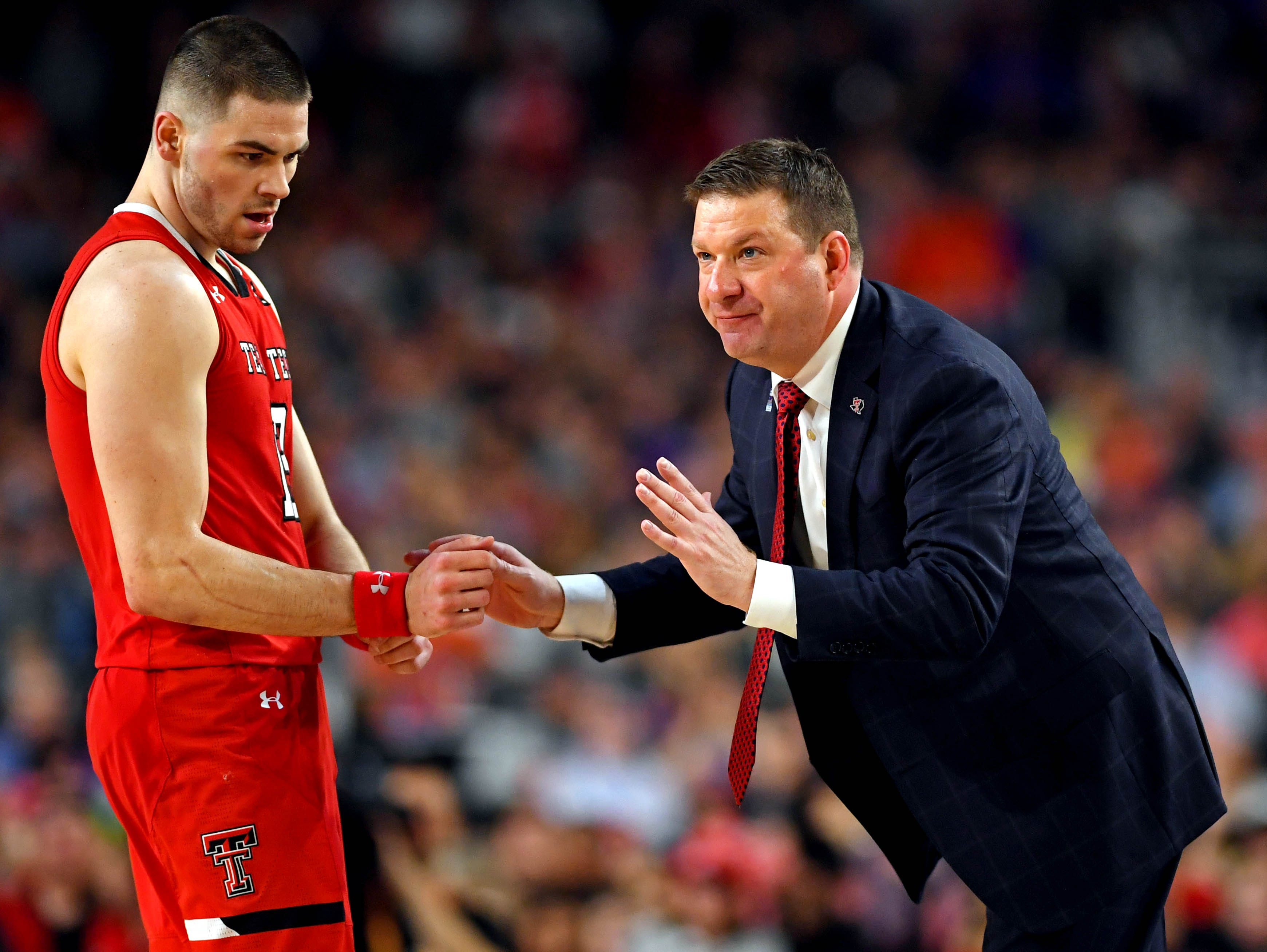 Apr 6, 2019; Minneapolis, MN, USA; Texas Tech Red Raiders head coach Chris Beard talks to Texas Tech Red Raiders guard Matt Mooney (13) during the second half against the Michigan State Spartans in the semifinals of the 2019 men's Final Four at US Bank Stadium. Mandatory Credit: Bob Donnan-USA TODAY Sports