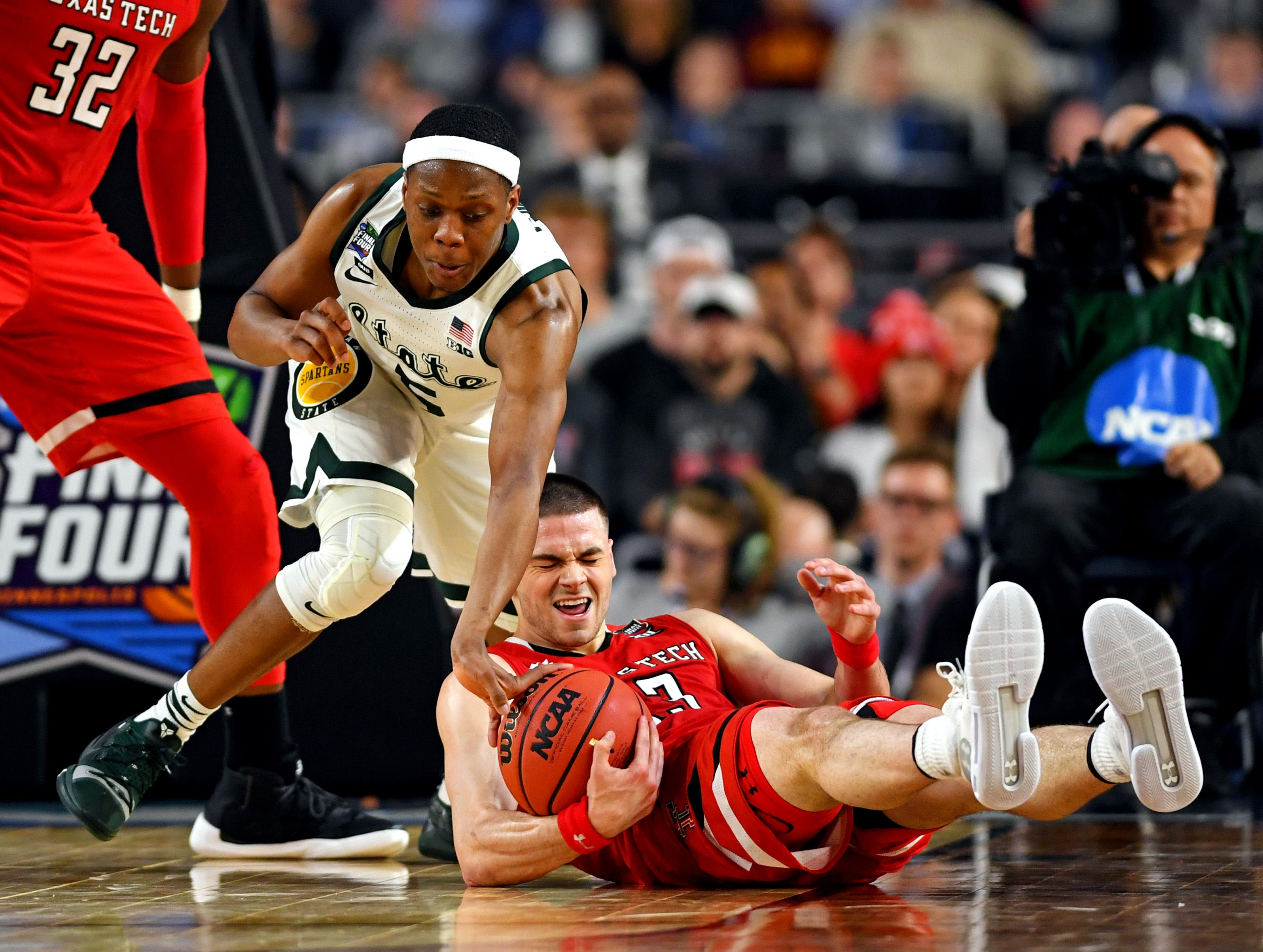 Apr 6, 2019; Minneapolis, MN, USA; Texas Tech Red Raiders guard Matt Mooney (13) falls to the court against Michigan State Spartans guard Cassius Winston (5) during the second half in the semifinals of the 2019 men's Final Four at US Bank Stadium. Mandatory Credit: Bob Donnan-USA TODAY Sports