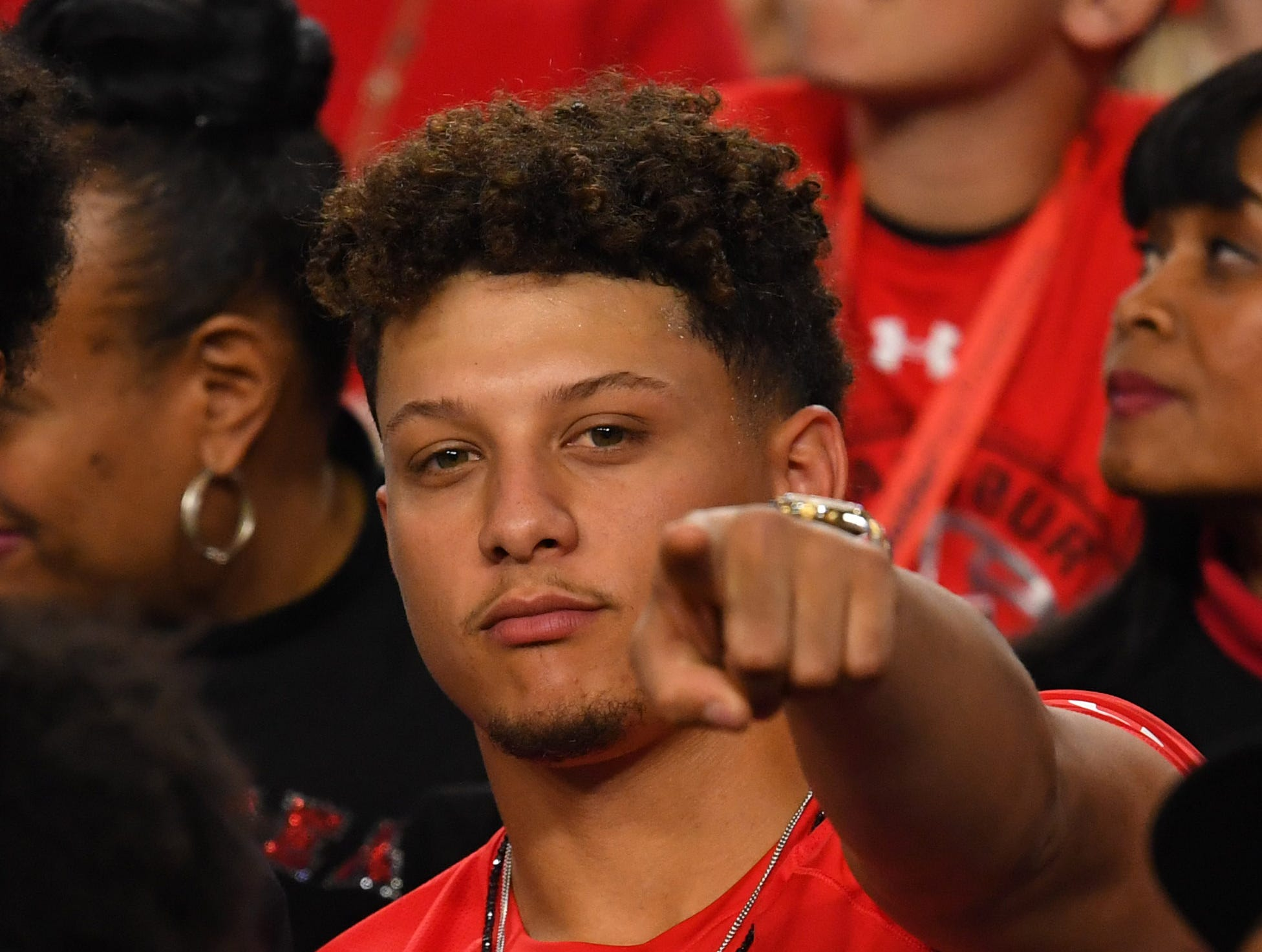 Apr 6, 2019; Minneapolis, MN, USA; Kansas City Chiefs quarterback and former Texas Tech Raiders quarterback Patrick Mahomes poses for a photo before the start of the semifinals against the Michigan State Spartans of the 2019 men's Final Four at US Bank Stadium. Mandatory Credit: Robert Deutsch-USA TODAY Sports